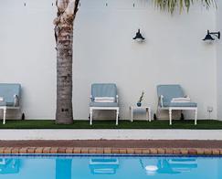 Accommodation-Banhoek-Lodge-Stellenbosch-Swimmingpool-Area-Palm-Trees